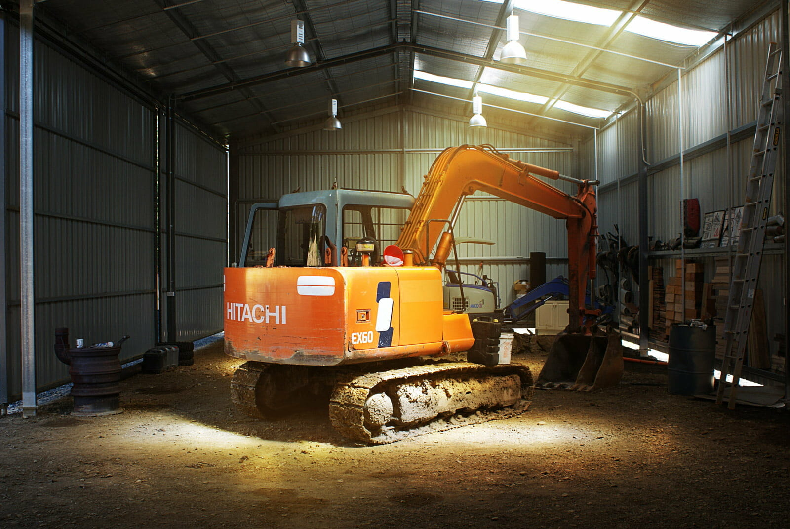 machinery shed with digger